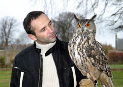 One of Winton's corporate hospitality clients with an Eagle Owl from Raptor World