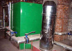 Hot water and heating in the House are provided by a wood chip boiler