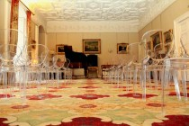 Drawing room with see through ghost chairs at Winton House