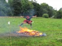 Francis Ogilvy jumping over Spartan bonfire.