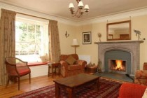 Relax round Winton Cottage's open fire