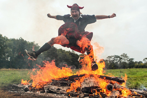 Francis Ogilvy jumps over fire - Spartan Race - Winton House