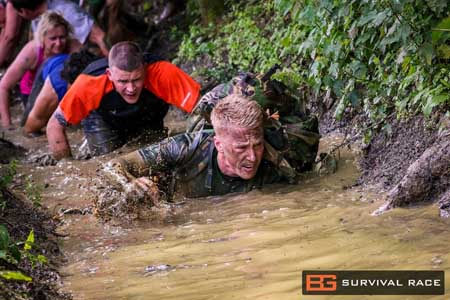 Bear Grylls Survival Race Training 6 Aug 2016 Winton House - Participants crawling in river
