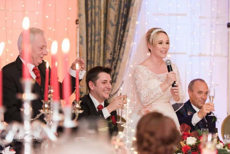 Bride making a speech at Winton Castle wedding.