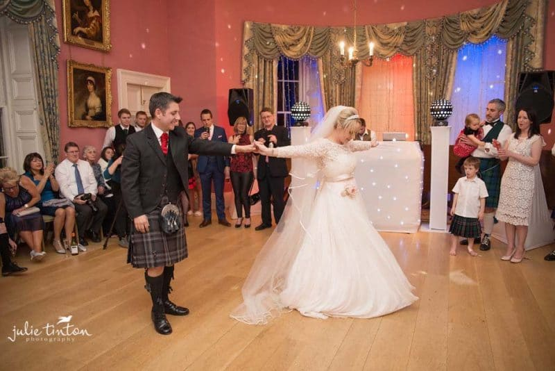 Bride and groom dancing at Winton Castle.