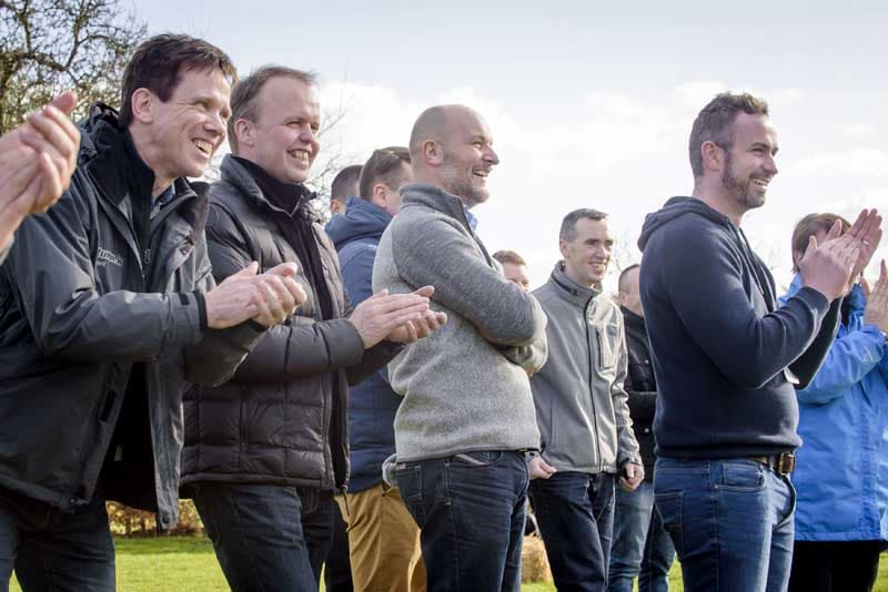 AGCO team watch colleagues doing Highland Games at Winton Castle.