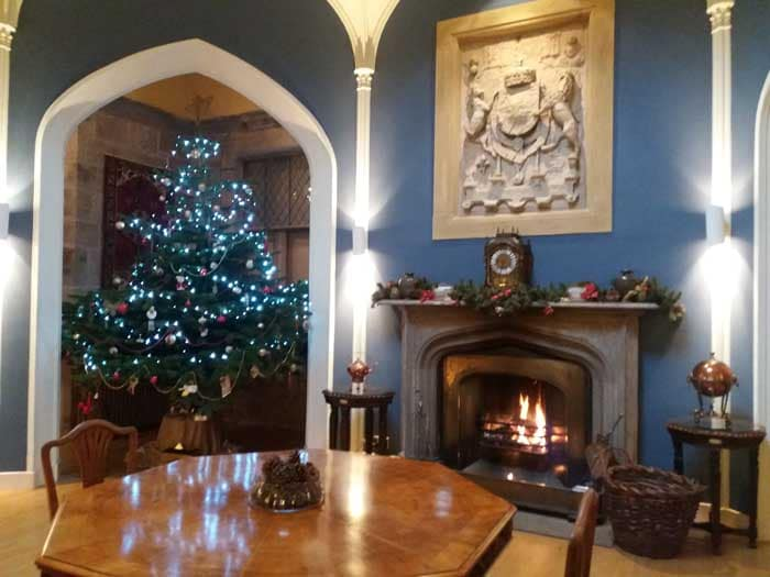 Christmas tree and burning fire at Winton Castle