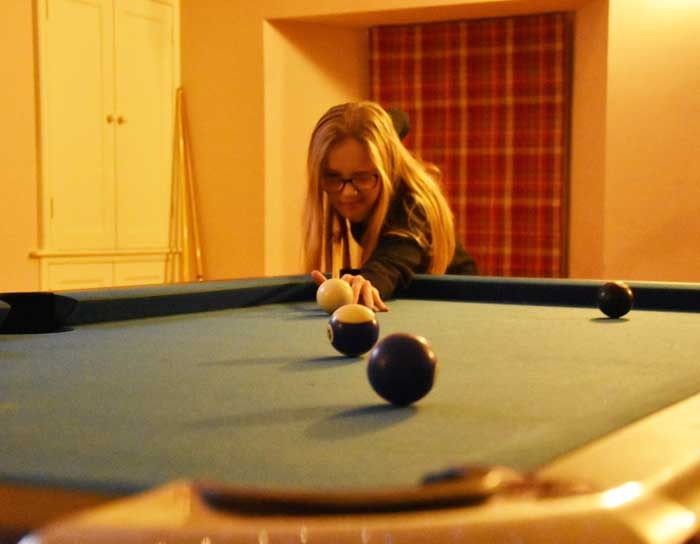 Playing pool at Winton Cottage self catering accommodation in East Lothian.