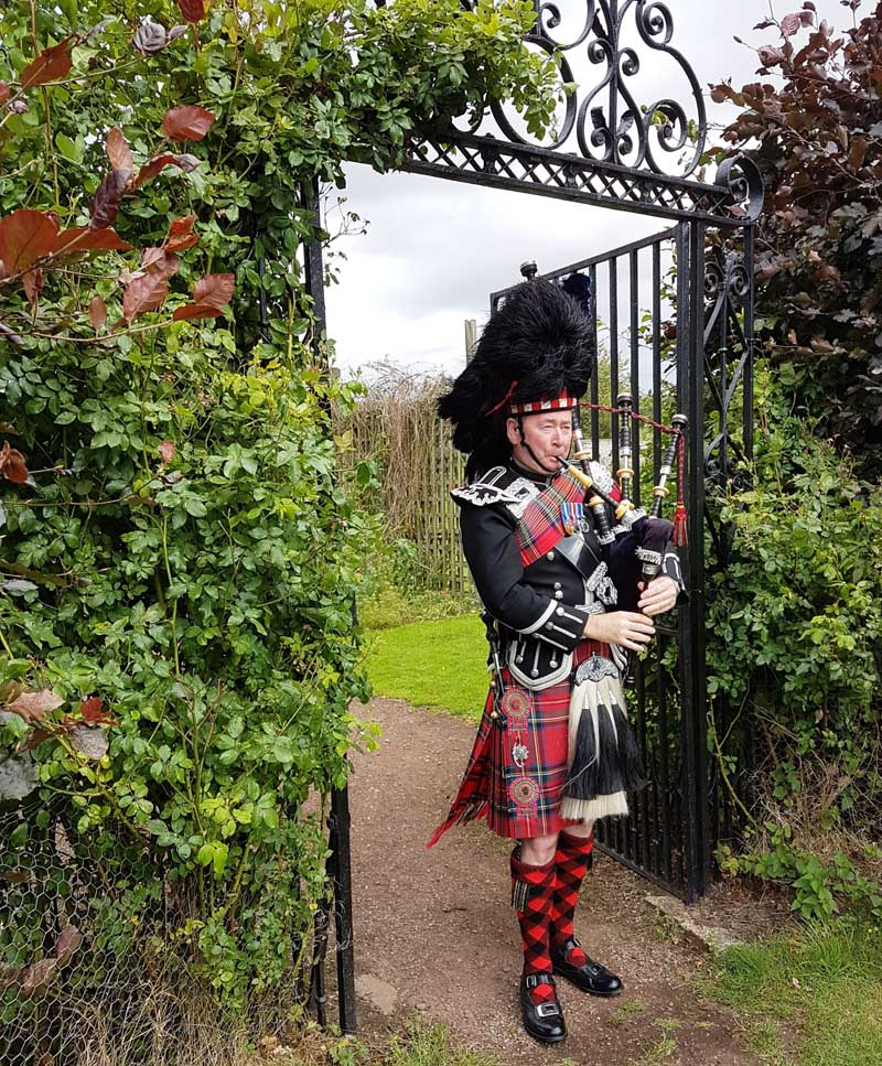 Piper at Winton Castle near Edinburgh