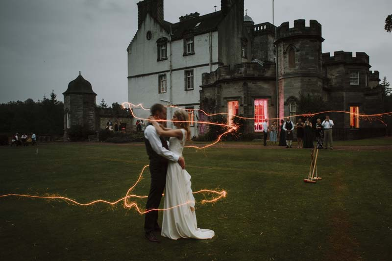 Wedding couple outside Winton Castle in the evening