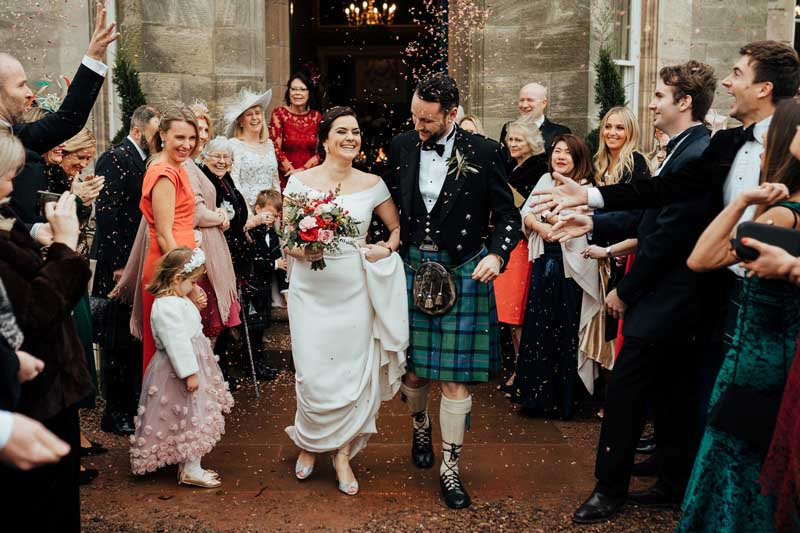 Wedding Couple & Confetti Outside Winton Castle