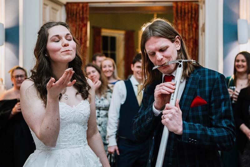 Vici & Steve Cut Wedding Cake at Winton Castle