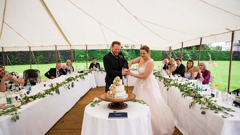 Cutting Wedding Cake in Winton Walled Garden