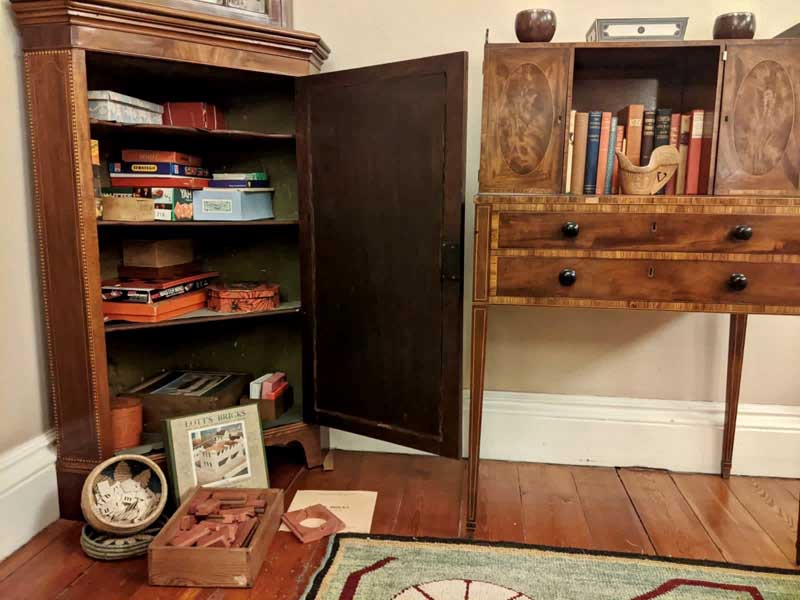 Open Family Games Cupboard at Winton Castle
